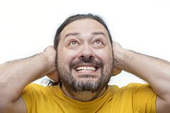 Free An Adult Man With A Sloppy Beard And Disheveled Hair Covers His Ears With His Hands Stock Photo - 190974980