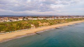 Free An Aerial View Of The Boscombe Beach With Sandy Beach, Calm Flat Water, Groynes Breakwaters, Grassy Cliff And Building In The Royalty Free Stock Photography - 164167077