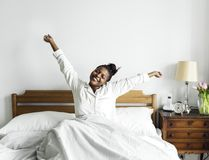 Free An African Woman Waking Up In Bed Royalty Free Stock Photography - 115365727