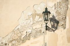 Free An Ancient Dark Green Squiggly Lantern Casting A Cloud Over A Grungy House Wall In Prag Royalty Free Stock Photography - 132760867
