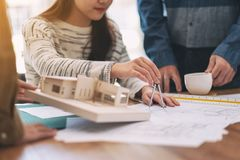 An Architect Using Compass To Draw And Measure Shop Drawing Royalty Free Stock Photography