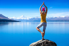 An Attractive Young Woman Doing A Yoga Pose For Balance And Stretching Near The Lake Royalty Free Stock Photos