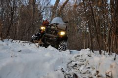 Free An ATV On Wheels Stands On A Taiga Forest Road In Winter Royalty Free Stock Photography - 163890837