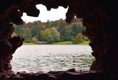 An Early Autumn / Fall Scene Through The Stone Window Of A Rustic Garden Grotto Stock Photo