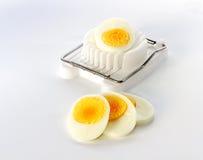 An Egg Slicer And Sliced egg