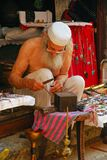 An Elderly Artisan Working On Traditional Handmade Ornament Stock Images