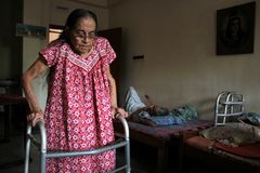 Free An Elderly Lady Helping Herself In An OLD AGE Home Stock Image - 166870641