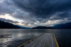 Free An Empty Old Wooden Dock On Harrison Lake Leads Into The Coming Storm Stock Image - 144757641
