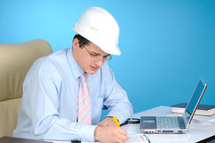 An Engineer With White Hardhat At Work Royalty Free Stock Photos