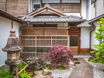 Free An Entrance To A Japanese Traditional Hotel. Sliding Doors At A Ryokan In Japan. A Yard Of A Traditional Japanese House In Kyoto Royalty Free Stock Image - 148249556