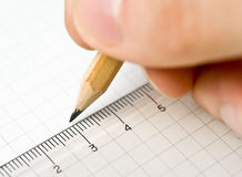 An Hand Who Writes In A Paper Sheet With A Pencil Royalty Free Stock Photography
