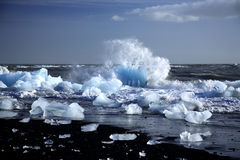 An Iceberg Being Broken By The Waves Stock Photo