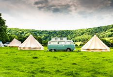 Free An Iconic VW Camper Or Kombi At A Glamping Site In The English Countryside Royalty Free Stock Photography - 154604397