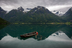 Free An Old Boat And Reflection Of The Mountains In The Water Royalty Free Stock Image - 50861236