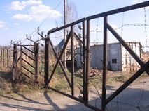 Free An Old Iron Fence With A Closed Rusty Gate Prohibits Travel To The Territory Of An Abandoned Technical Station Royalty Free Stock Image - 159301566