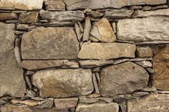 An Old Stone Wall Brown Large Stones. Classical Masonry Walls Of Medieval Castles In Europe. Stock Photography