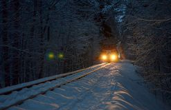 Free An Old Vintage Train With Carriages Rides Through A Winter Snowy Forest Royalty Free Stock Photography - 141083417