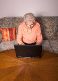 An Old Woman With A Laptop Royalty Free Stock Image