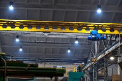 Free An Overhead Crane In A Workshop At A Factory, Operated By A Cran Stock Images - 215970654