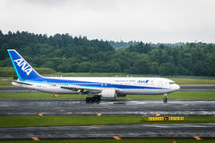 ANA aircraft - Boeing 767-381 - taxing at Narita International Airport stock photo
