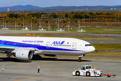 ANA Airplane is taking off. At New Chitose Airport in Hokkaido, Japan royalty free stock images
