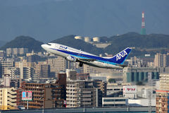 ANA All Nippon Airways Boeing 737-500 airplane. Fukuoka, Japan - October 13, 2015: A ANA All Nippon Airways Boeing 737-500 with the registration JA302K takes off stock images