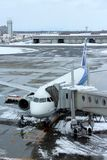 ANA flight loading at Chitose airport on a snowy day Sapporo Royalty Free Stock Images