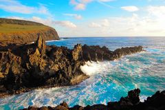 Ana Kai Tangata Cave. Waves breaking at the cliffs in front of the Ana Kai Tangata Cave close to Hanga Roa in Rapa Nui, Easter Island in Chile, South America stock photography