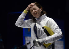 Ana Maria Branza. Romanian Fencer Ana Maria Branza reacts during her game against Anca Maroiu counting for the Romanian National Women Fencing Championship Stock Photos