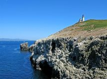 Anacapa lighthouse. Lighthouse above rocky cliffs, Anacapa Island, Channel Islands National Park, California Stock Photography