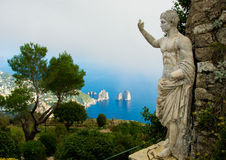 AnaCapri landscape. Landscape shot of Capri with blue grotto in background and statue in foreground Stock Image
