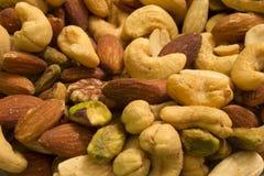Anacardos, almendras, pistachos y pacanas Imagen de archivo libre de regalías