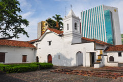 Anachronism, old versus new in Cali, Colombia.  Stock Photo