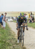 Anacona Gomez Riding on a Cobblestone Road - Tour de France 2015 Royalty Free Stock Images