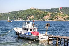 Anadoluhisari region in Istanbul. Fisher boat berthed at Bosporus coast in Istanbul Stock Images