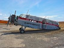 Debris of vintage Soviet civil passenger airplane with no tail and wings corroding outdoors at scrap metal storehouse on scenic na. Anadyr, Russia - July 8, 2006 royalty free stock image