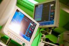 Anaesthesiolog monitors in operation surgery room Stock Photography