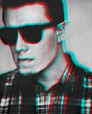 Anaglyph effect of young man in sunglasses. royalty free stock image