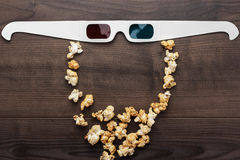 Anaglyph glasses and popcorn making bearded face Royalty Free Stock Photography