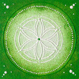 Anahata the heart chakra. Hand painted seed of life with green and withe colours Royalty Free Stock Photo