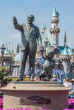 Walt Disney and Mickey Mouse statue at Disneyland. Anaheim, CA: July 8, 2014: Mickey Mouse and Walt Disney statue in front of the Sleeping Beauty Castle at royalty free stock photos