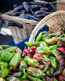 Anahiem Peppers. Wicker basket filled with green and red Anahiem Peppers at a San Francisco farmers market royalty free stock image