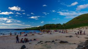 Anakena beach time lapse in Easter Island with blurred tourists. Anakena beach time lapse with many blurred tourists and iconic boat in Easter Island stock video footage