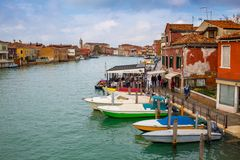 сanal in Venice, trattoria and boats Royalty Free Stock Image