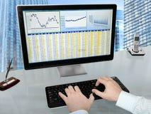 Analizing Data on Computer Stock Image