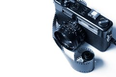 Analog Camera. A vintage rangefinder camera and spool of photography film Stock Images