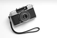 Analog camera. Old analog photographic camera on white Stock Photos