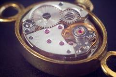 Analog clock metal mechanism close up Stock Image