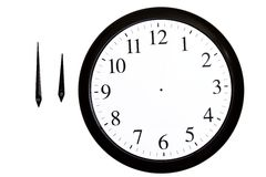 Analog clock with separated arrows. On a white background royalty free stock photos