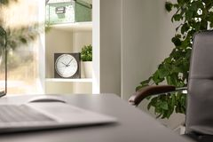 Analog clock on shelf in office. Time to work royalty free stock photography